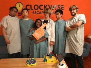the asylum escape room players